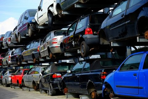 Scrap cars stacked on top of each other in a junkyard