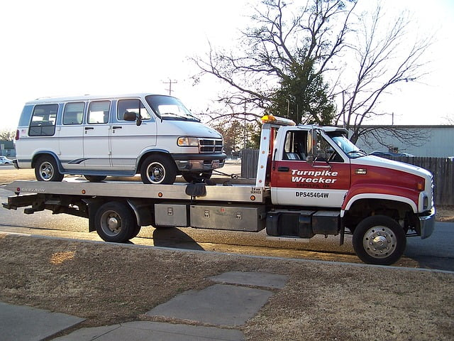 Old van being towed away.